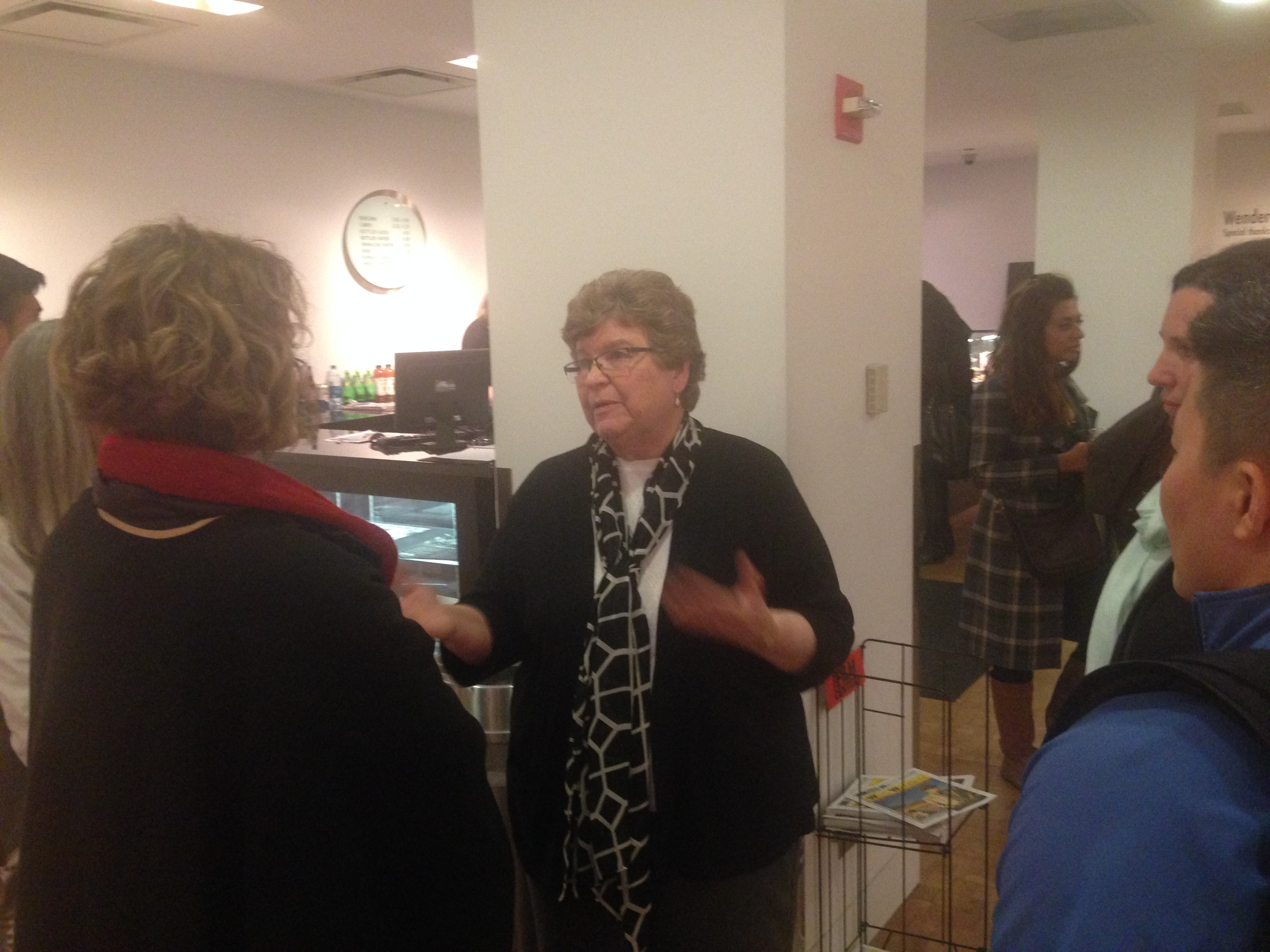 Sr. Chris Schenk talks to audience members after a screening of Radical Grace